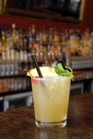soporific: Mai Tai punch with mint, cherry and pineapple decoration and black straw. Stock Photo