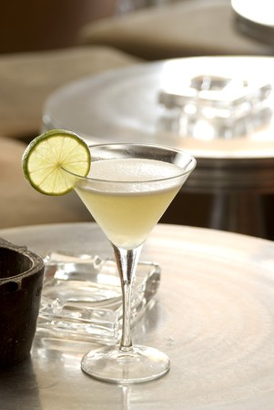 Lemon Daiquiri with a slice of lemon in a martini-glass. photo