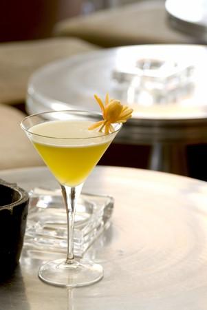 intoxicating: Illusion Daiquiri with orange flower in a martini-glass. Stock Photo