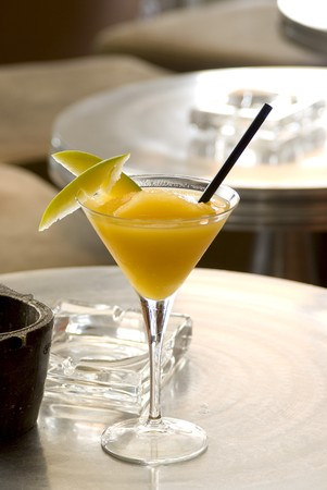 intoxicating: Mango Daiquiri with two slices of mango in martini-glass Stock Photo