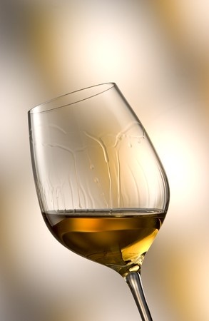 soporific: Glass of white wine in yellow-brown ambiance