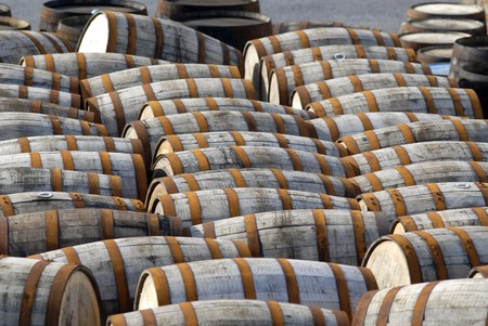 Barrels with rusted metal rings in a yard. Stock Photo - 8182300