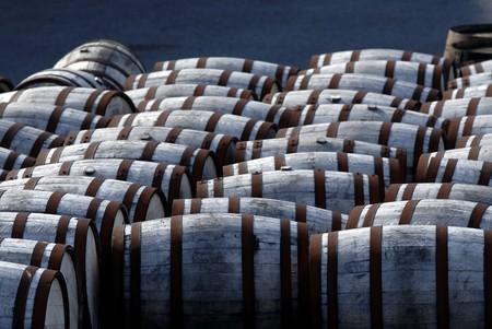 Barrels with rusted metal rings in a yard. Stock Photo - 8192981