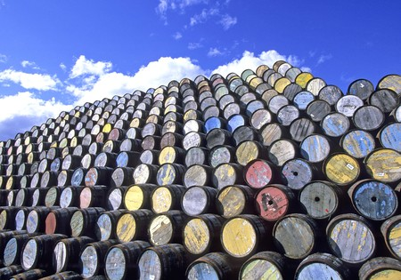 Barrels with rusted metal rings in a yard, pilled up. Stock Photo - 8184186