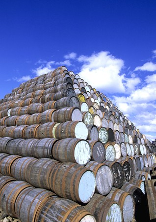 Barrels with rusted metal rings in a yard, pilled up. Stock Photo - 8185993