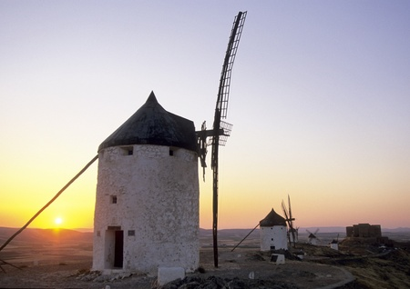 Beatifull old windmill in front of a red sunset. Stock Photo - 8288122