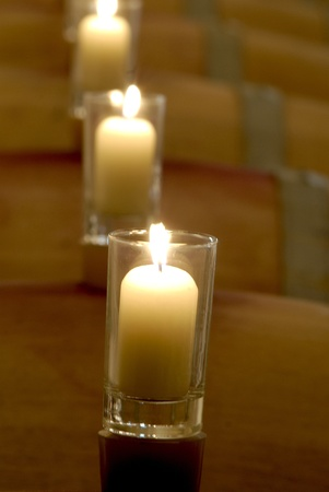 Candles in line standing on top of barrels. Stock Photo - 8288125