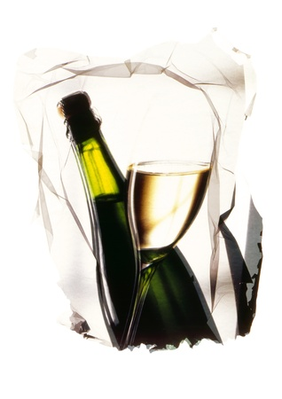 glass and bottle of white wine presented in an artistic way photo