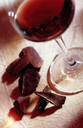glass of red wine with chocolate photo