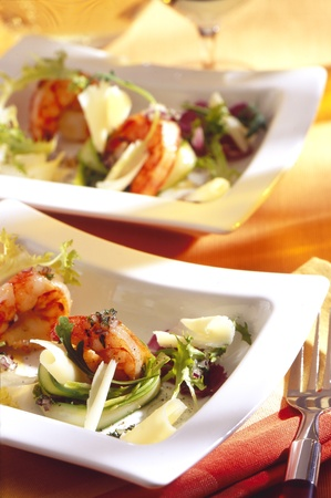 gambas: gambas with vegtables on a white plate.