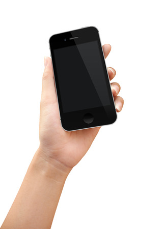 over white: Women hand holding phone action over white background Stock Photo