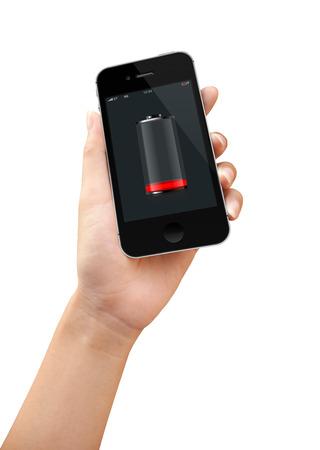 bateria: Teléfono inteligente en mano de las mujeres es de batería baja Foto de archivo