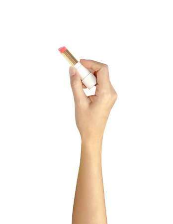 gripping: hand of women gripping lipstick in writing action over white background Stock Photo