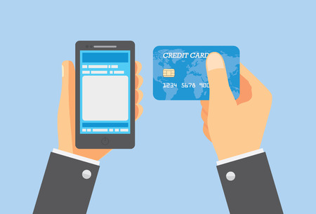 holding credit card: Pay online with credit card and smartphone