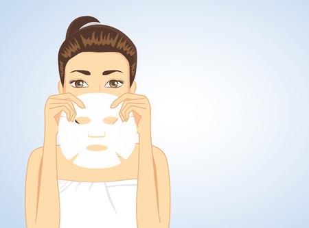 Beautiful woman holding facial sheet mask hide half face. beauty concept