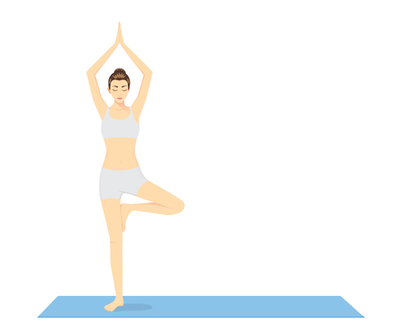 Woman beginning in Yoga with Tree Pose or Vrksasana on blue exercise mat. This pose is performed to warm up.