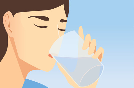 Face close up while woman drinking water with transparent glass.