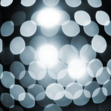Defocused abstract sparkling lights background photo