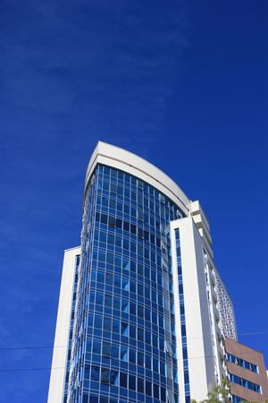 highriser: Modern office building over blue sky.