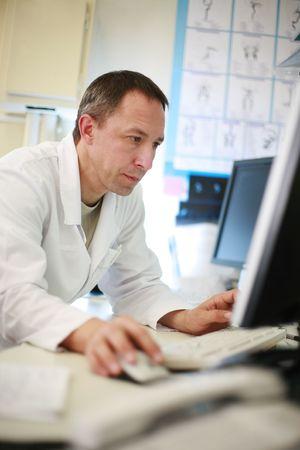 Doctor using computer, portrait