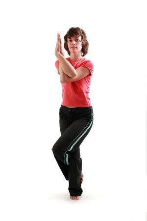 Yoga poses series. The Eagle Pose. Garuda-asana. Isolated on white background. photo