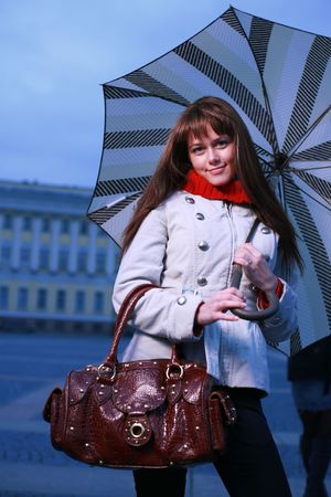 designer bag: Fashion girl with umbrella at Palace Square, St. Petersburg, Russia. Stock Photo