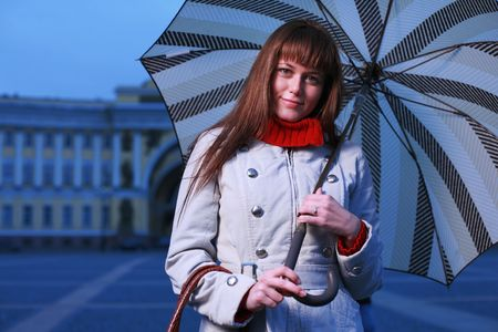 Fashion girl with umbrella at Palace Square, St. Petersburg, Russia. photo