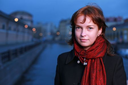 st petersburg: Portrait of a young redhead woman standing by a canal in St. Petersburg, Russia.