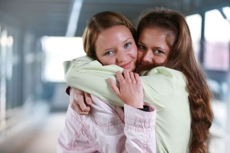 tight focus: Two girls hugging Stock Photo