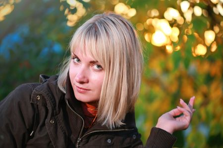 Portrait of a beautiful blond woman over autumn background Stock Photo - 2458674