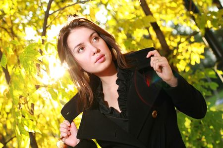 Beautiful young woman posing in yellow autumn forest. photo