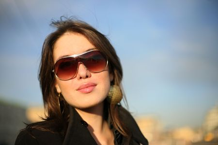 Portrait of a beautiful young woman in a city. Shallow DOF. photo