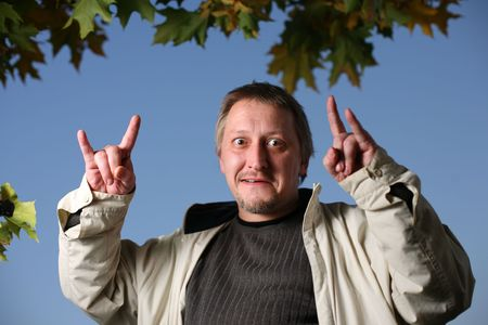Mature man throwing the goat Stock Photo - 2458677