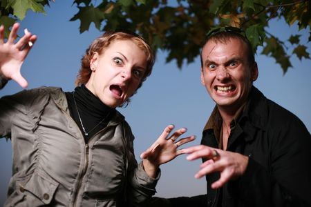 bared teeth: Scary looking couple portrait. Stock Photo