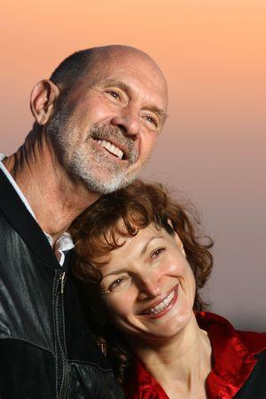 Loving senior couple portrait at sunset Stock Photo