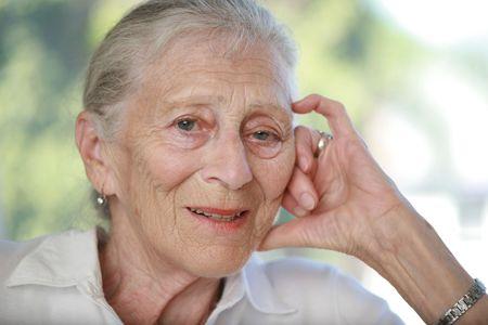 shallow dof: Close-up portrait of senior woman contemplating. Shallow DOF.