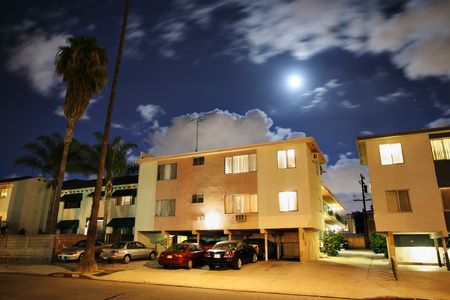 Residential street with apartment buildings at night at Los Angeles, California.