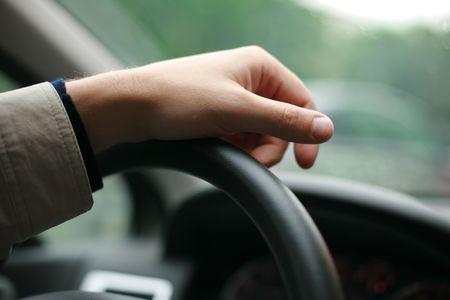 shallow dof: Drivers hand on steering wheel. Shallow DOF.