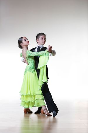 Boy and girl dancing ballroom dance