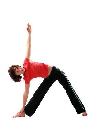 Yoga poses series. Trikonasana. The Triangle Pose. Isolated on white background. 免版税图像