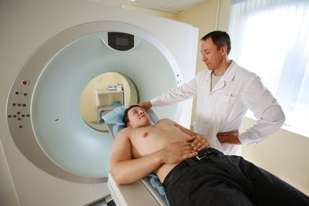 manipulating: Patient and doctor ready to do CAT scan with CT scanner.