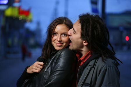 Young loving couple in a city. Biting a chick. Stock Photo - 2475812