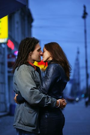 Young loving couple kissing in a city. photo