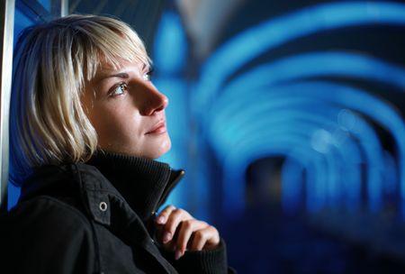 Portrait of a beautiful blond woman at night photo