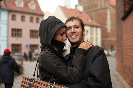 Young couple embracing in an old european town square. Stock Photo - 2475816