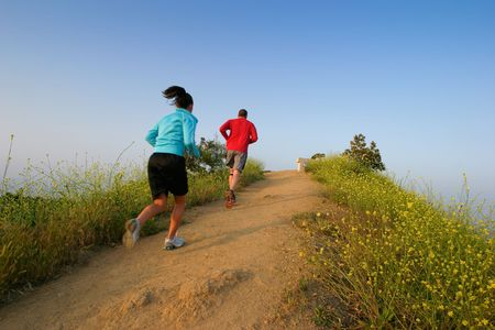 Two people running at Runyon Canyon Park, Hollywood Hills, California USA