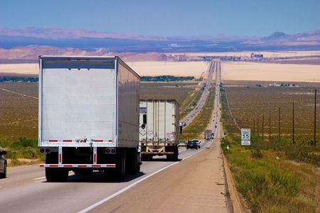 freight traffic: Interstate delivery trucks on a highway.