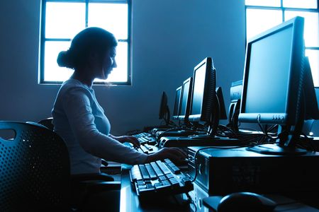 Student in Her College Computer Lab. Stock Photo