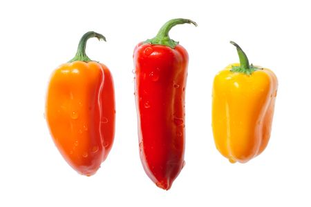 Three Fun Peppers Isolated On White photo