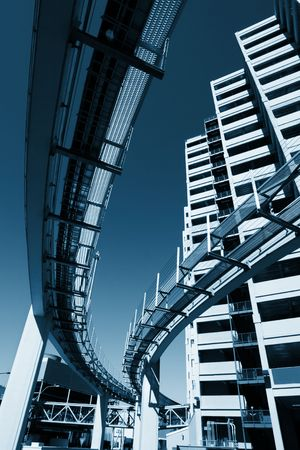 dynamic growth: Futuristic monorail going around skyscrapers. Wide angle view. Stock Photo